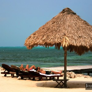 tourists sunbathing in san pedro, belize