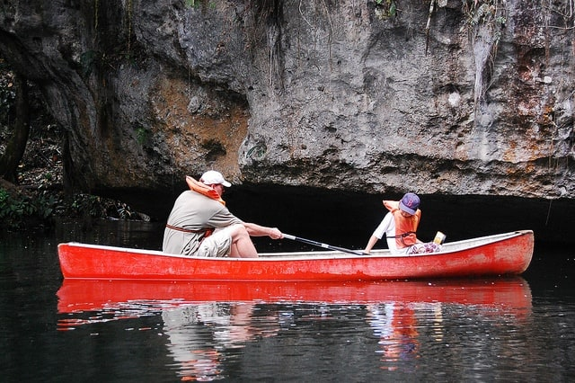 Father and son paddling around the pools before entering the cave.